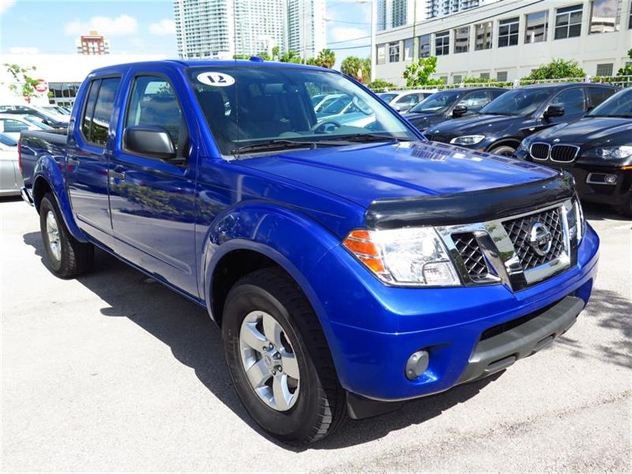 2012 NISS FRONTIER 2WD Crew Cab SWB Auto SV 55558 miles 2 auxiliary pwr outlets 6040 split re