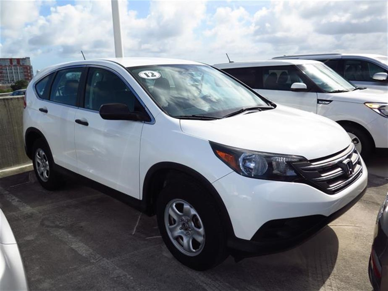 2012 HONDA CRV 2WD 5dr LX 15593 miles 4 cargo area tie-down anchors 8 cup holders 12V pwr o