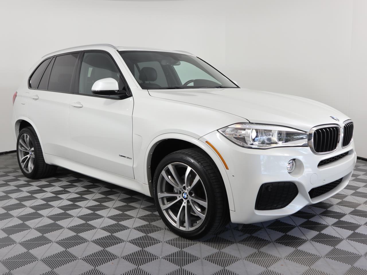 2014 BMW X5 RWD 4dr sDrive35i 6361 miles 2 Seatback Storage Pockets 4 12V DC Power Outlets LEATH