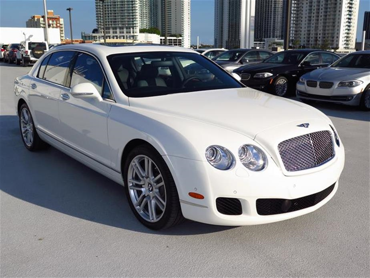 2013 BENTLEY CONTINENTAL FLYING SPUR 4dr Sdn 1358 miles 4-spoke monotone leather trimmed steering