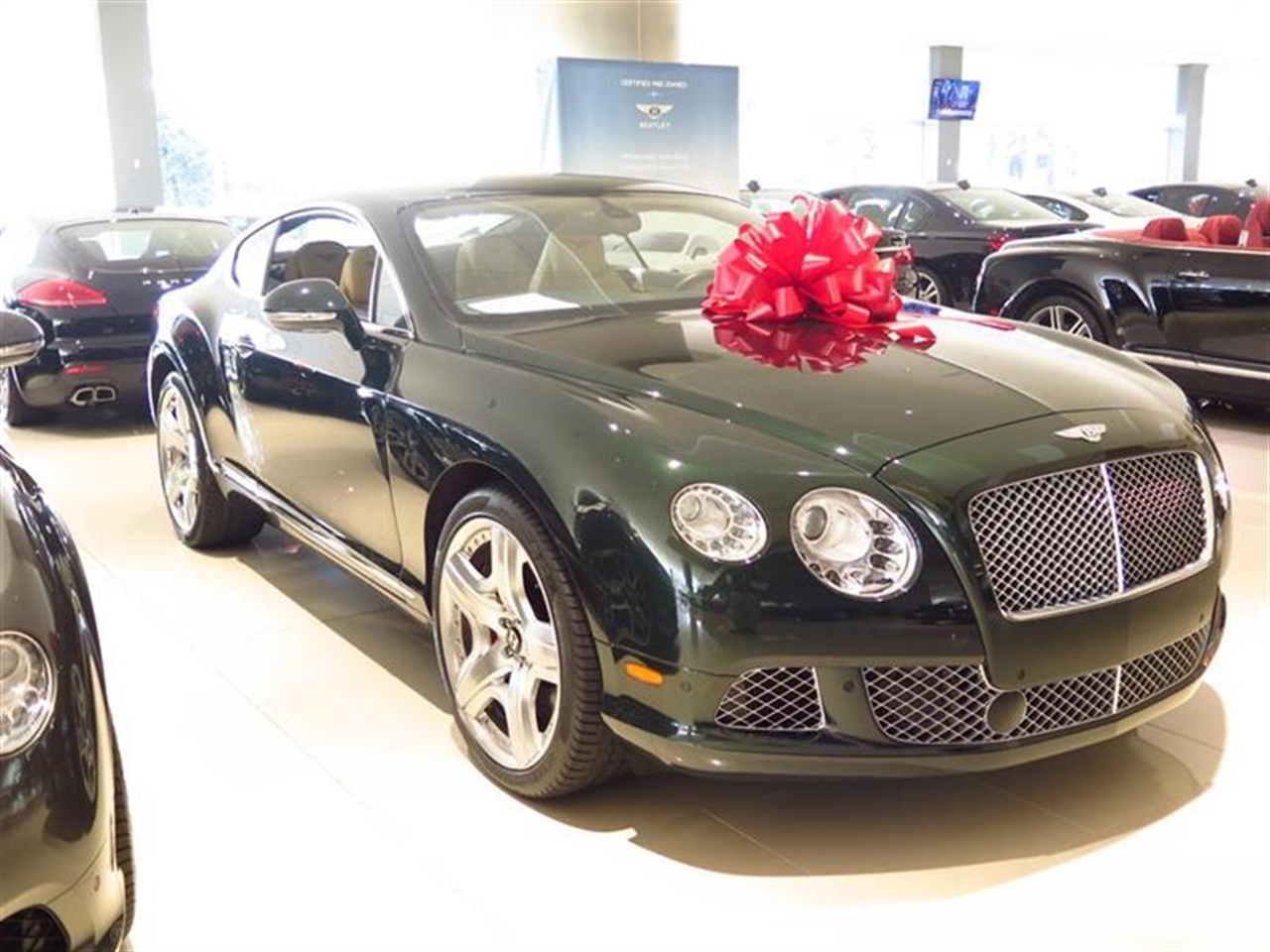 2012 BENTLEY CONTINENTAL GT 2dr Cpe 9567 miles 3-spoke monotone leather trimmed steering wheel Ch