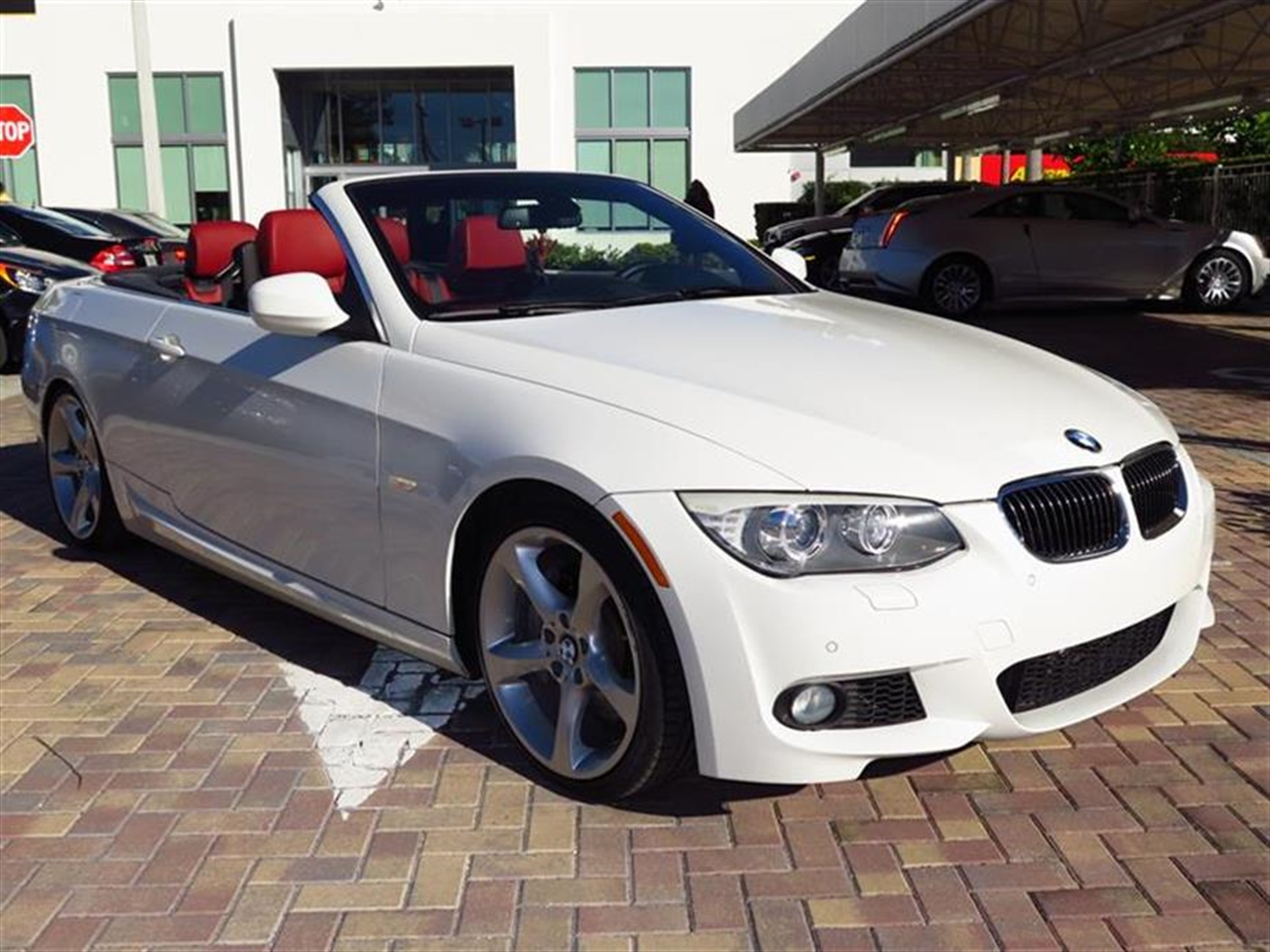 2012 BMW 3 SERIES 2dr Conv 335i 20670 miles 10-way power front bucket seats with 2-way manual head