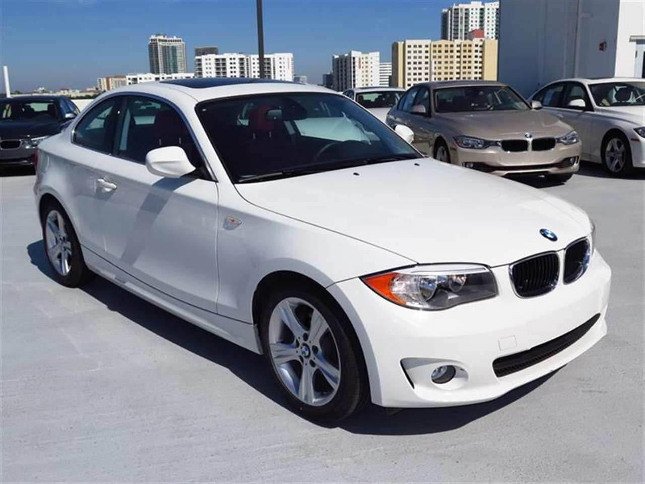 2012 BMW 1 SERIES 2dr Cpe 128i 13230 miles 3-spoke leather-wrapped multi-function sport steering