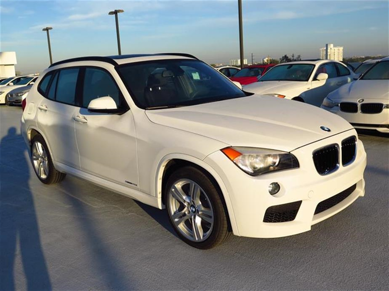 2013 BMW X1 RWD 4dr 28i 12124 miles Adjustable front armrest Anti-theft alarm system Automatic c