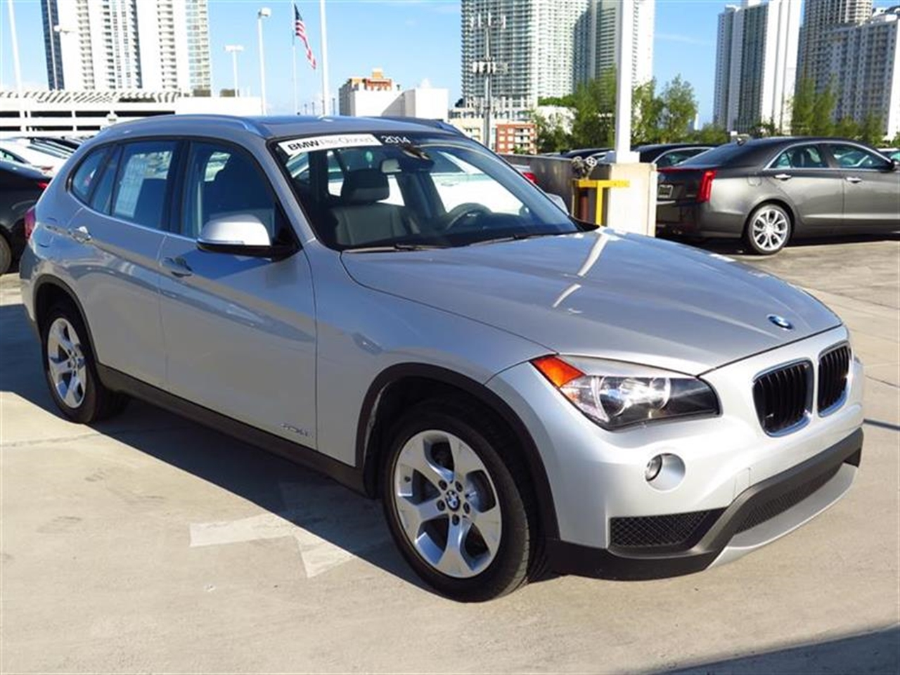 2014 BMW X1 RWD 4dr sDrive28i 9018 miles 2 Seatback Storage Pockets 3 12V DC Power Outlets LEATH