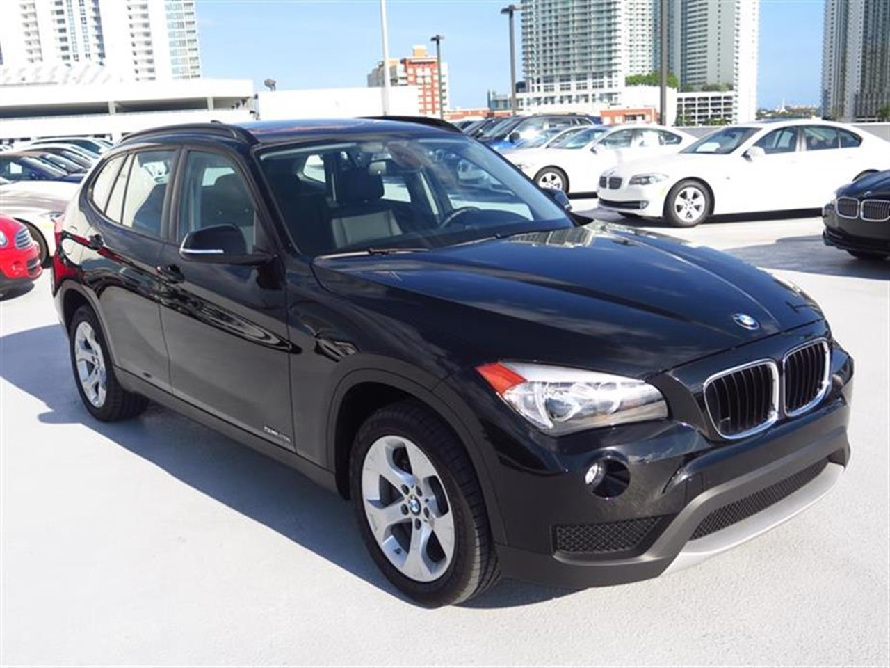 2013 BMW X1 RWD 4dr 28i 9605 miles Adjustable front armrest Anti-theft alarm system Automatic cl