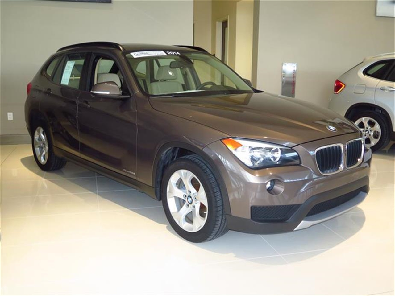 2014 BMW X1 RWD 4dr sDrive28i 9958 miles 2 Seatback Storage Pockets 3 12V DC Power Outlets LEATH