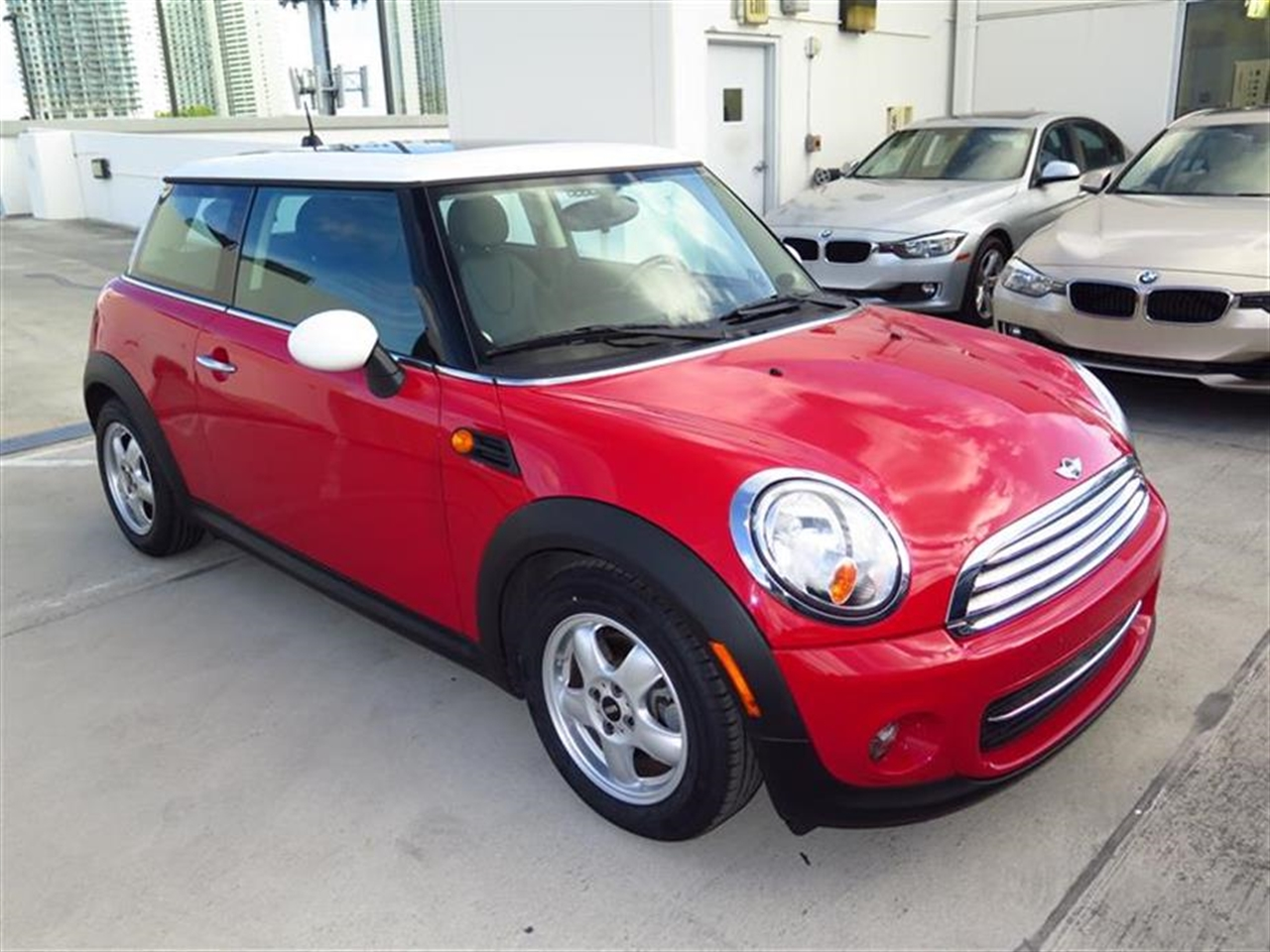 2011 MINI COOPER HARDTOP 2dr Cpe 26922 miles 1 rear cup holder 12V auxiliary pwr outlet in cock